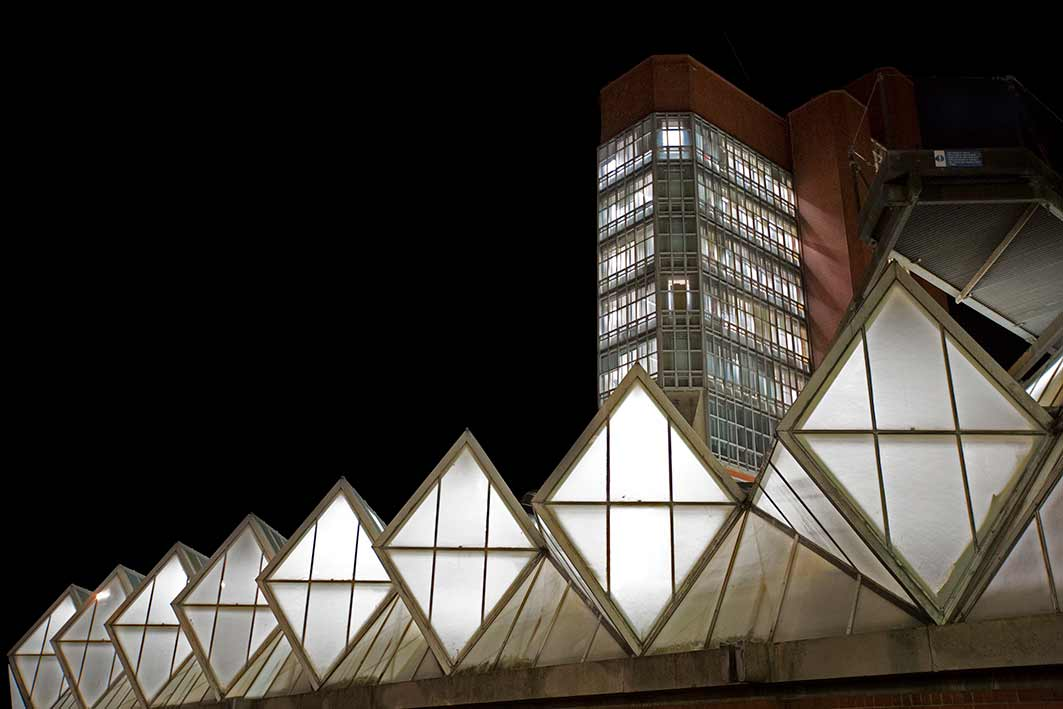The famous glass roof lit up at night - University of Leicester