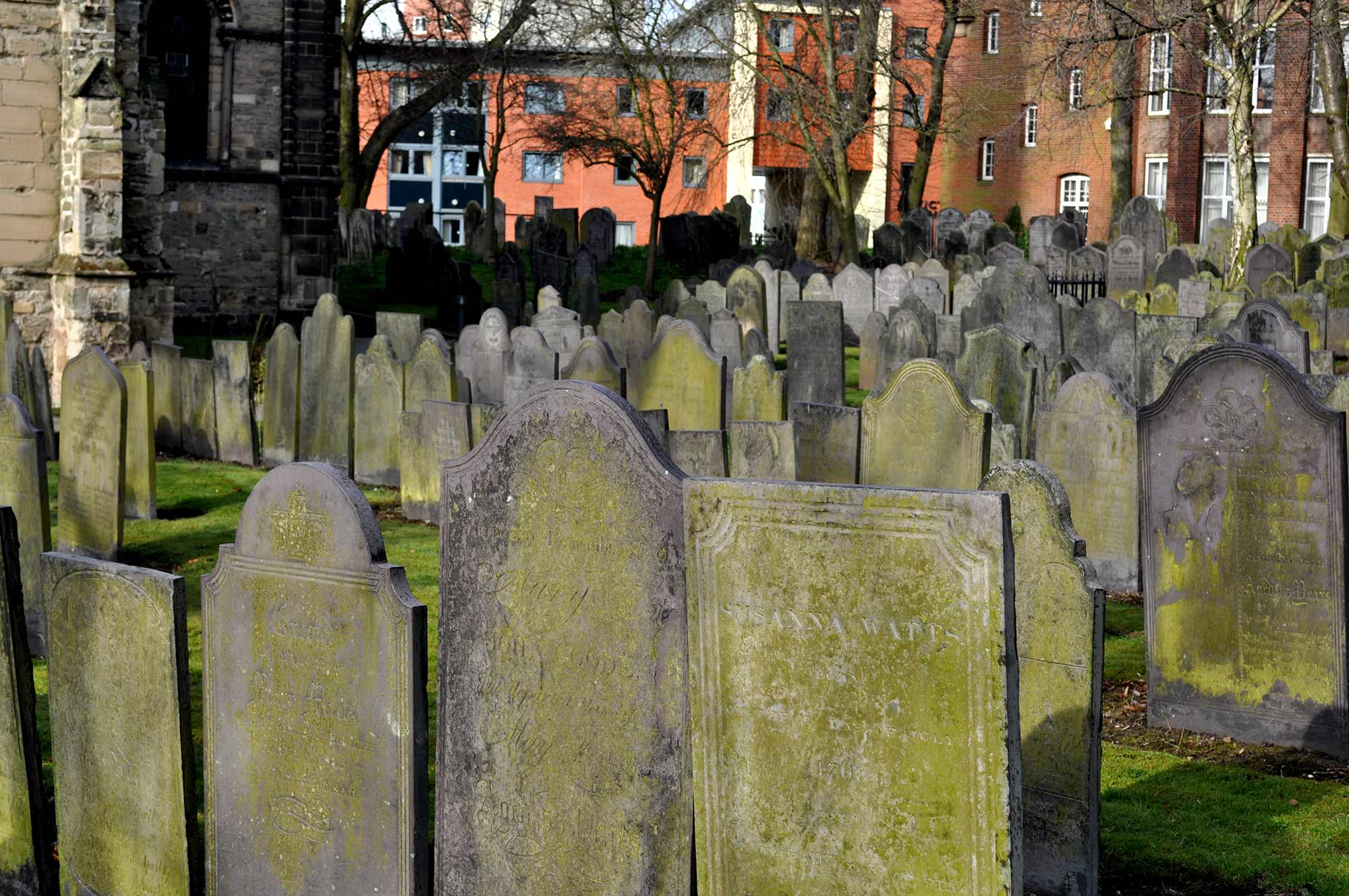 The churchyard houses many old gravestones -