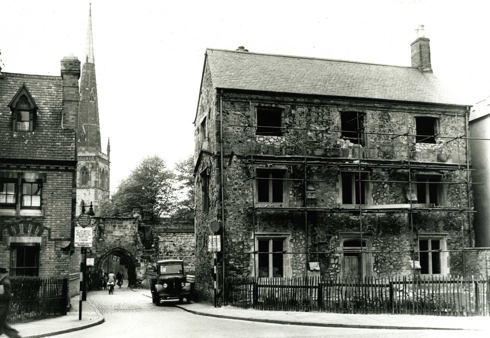Chantry House with scaffolding after bomb damage during WWII -