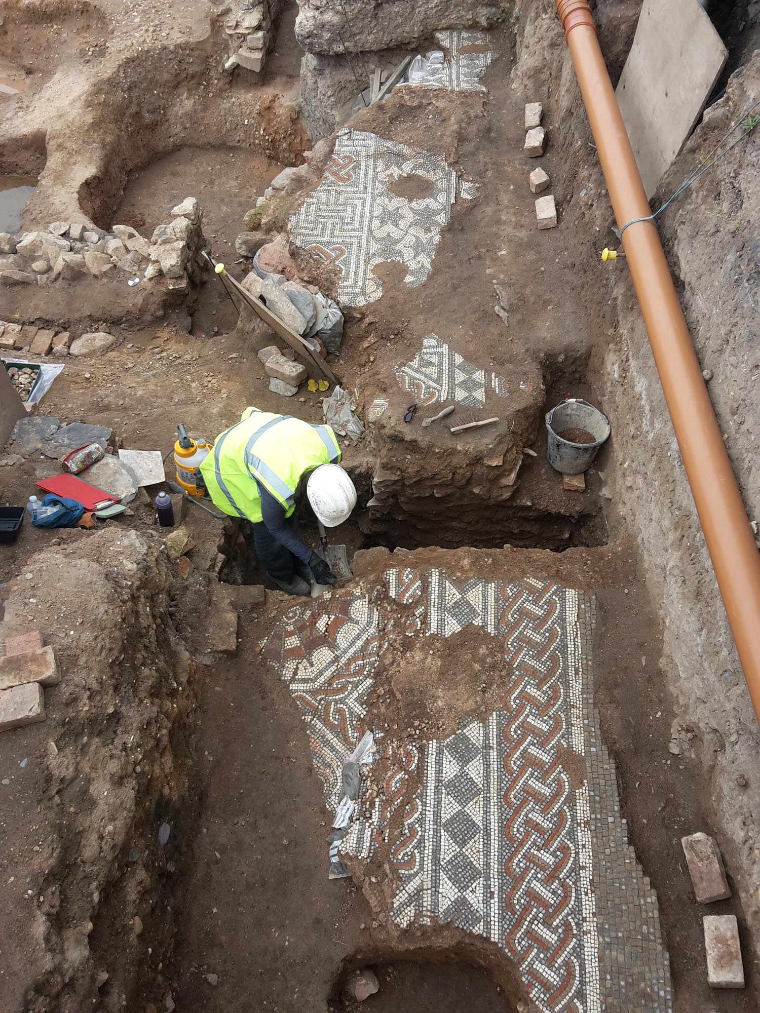 Part of an intricately decorated Roman mosaic is excavated near Vaughan Way and Highcross Street - University of Leicester Archaeological Services