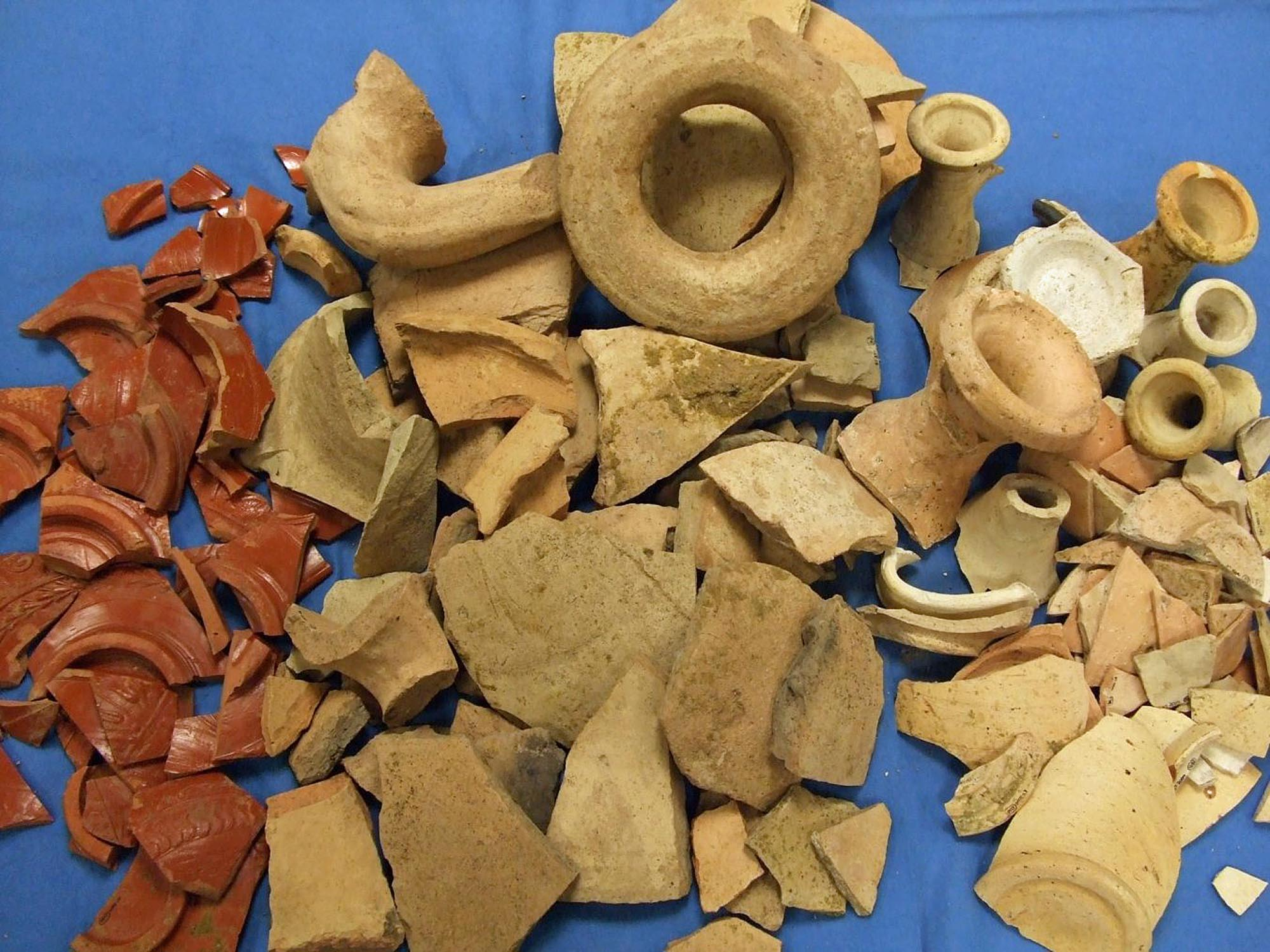 Broken pottery from a refuse pit behind a Roman shop near St Nicholas Circle. The assemblage included bowls, amphorae, jars and flagons suitable for storing and displaying food - University of Leicester Archaeological Services
