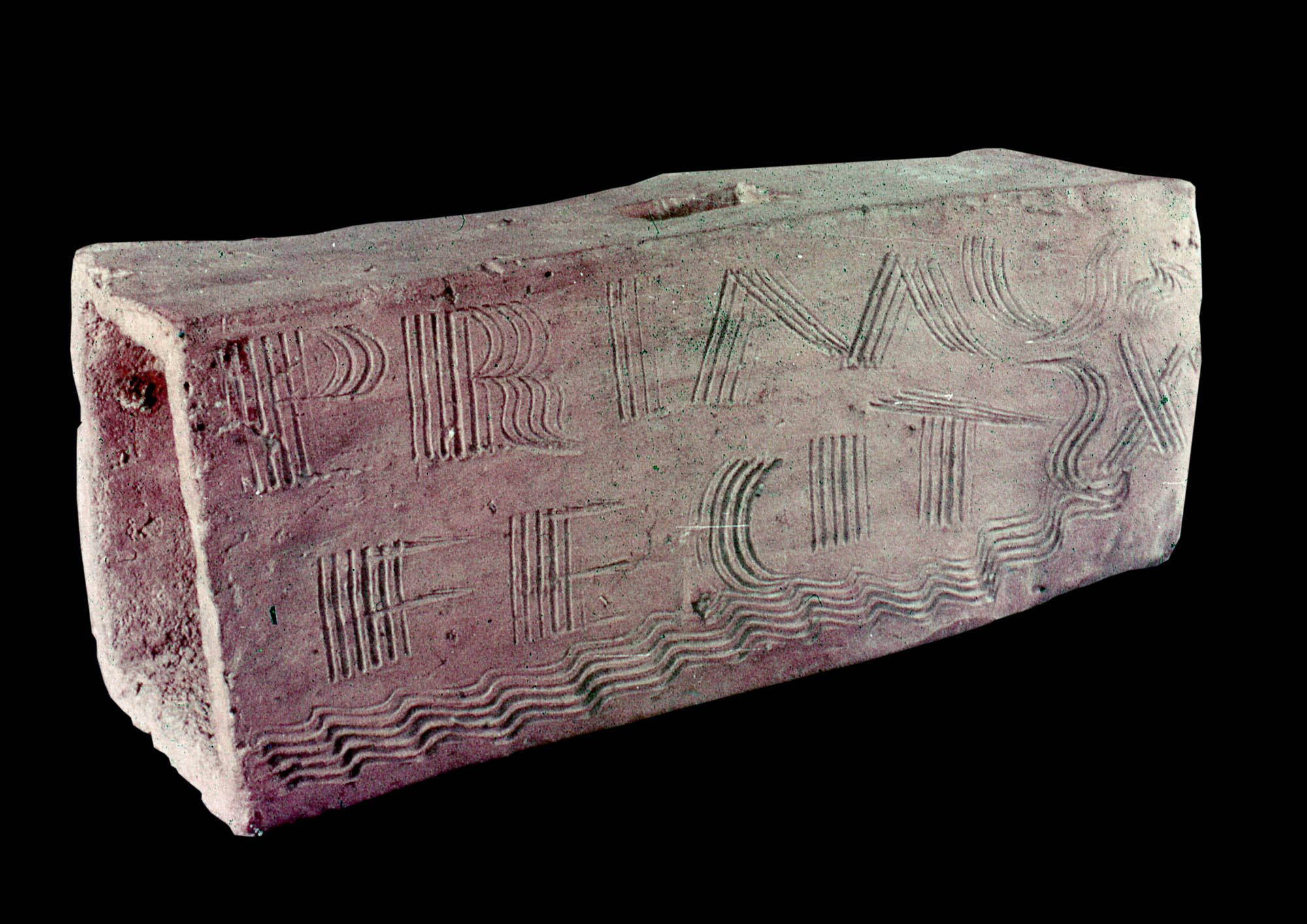 A Roman tile maker from Leicester has written the words PRIMUS FECIT X, meaning 'Primus has made ten tiles', on this box flue before it was fired - Leicester Arts & Museums Service