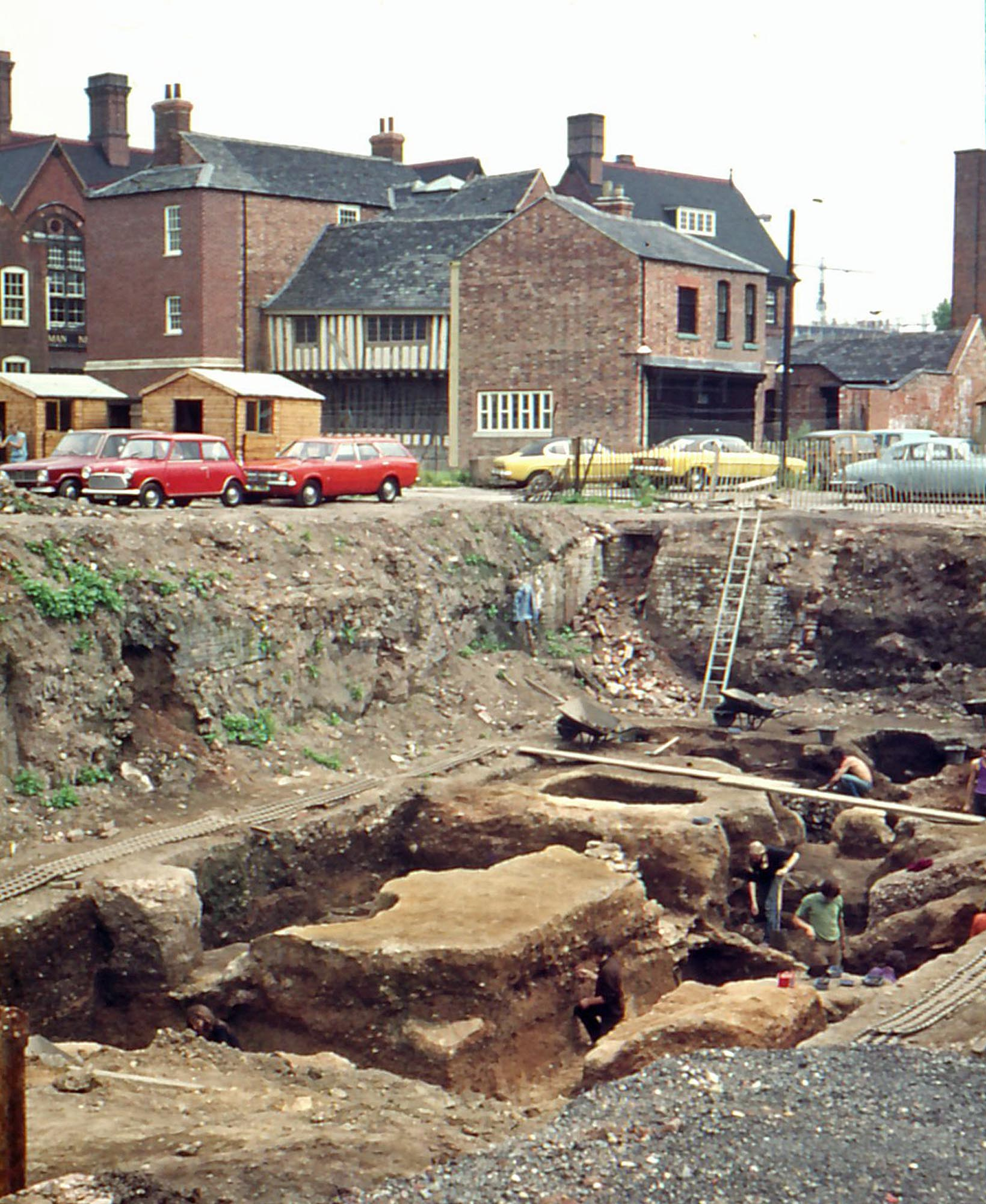 Looking south-east across the excavation of the Roman forum at St Nicholas Circle in the early 1970s. Wygston's House can be seen in the background - University of Leicester Archaeological Services