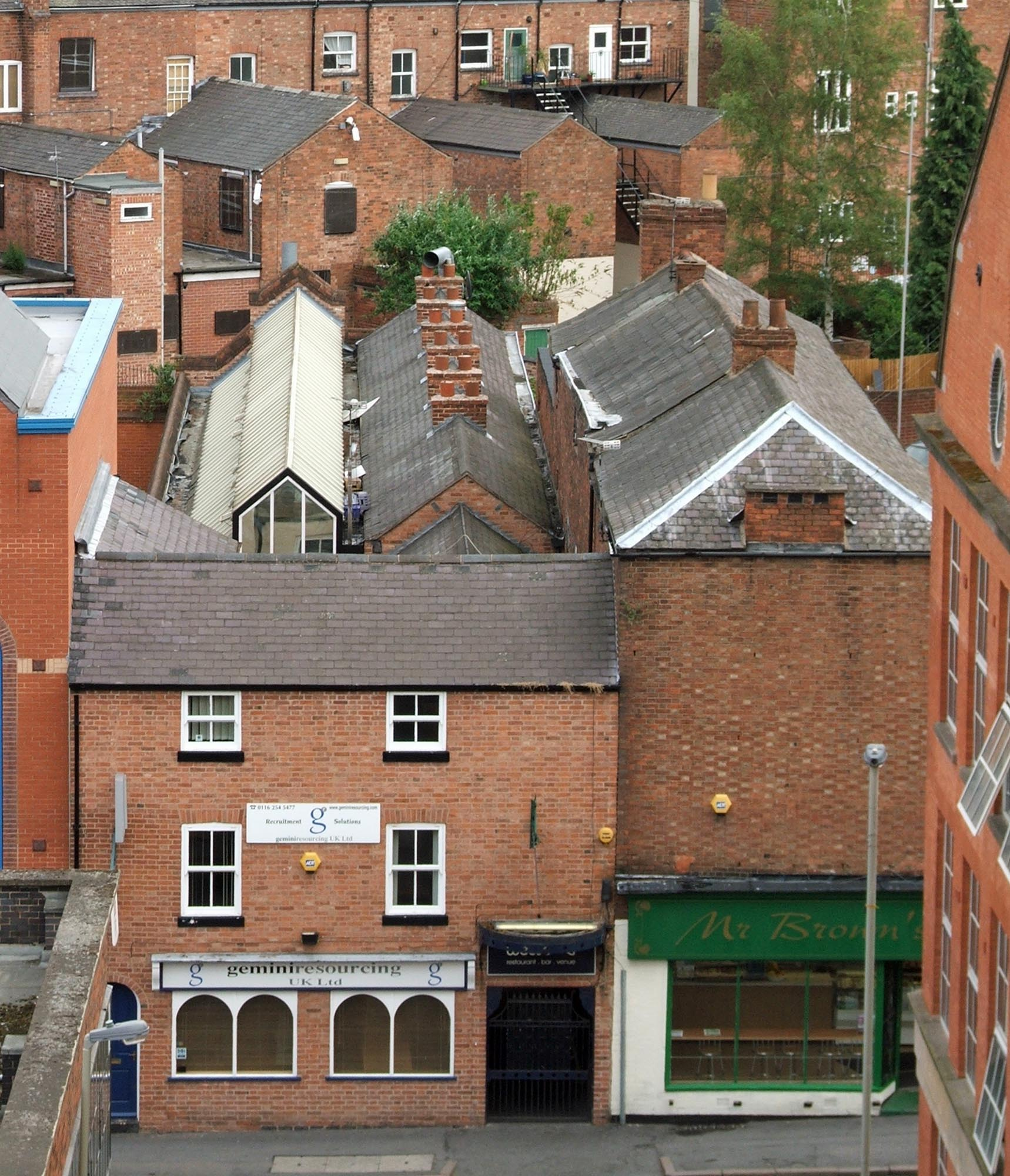 Looking down on Cramants Yard (and Cottages) showing the now covered outdoor area (white roof to the left) -