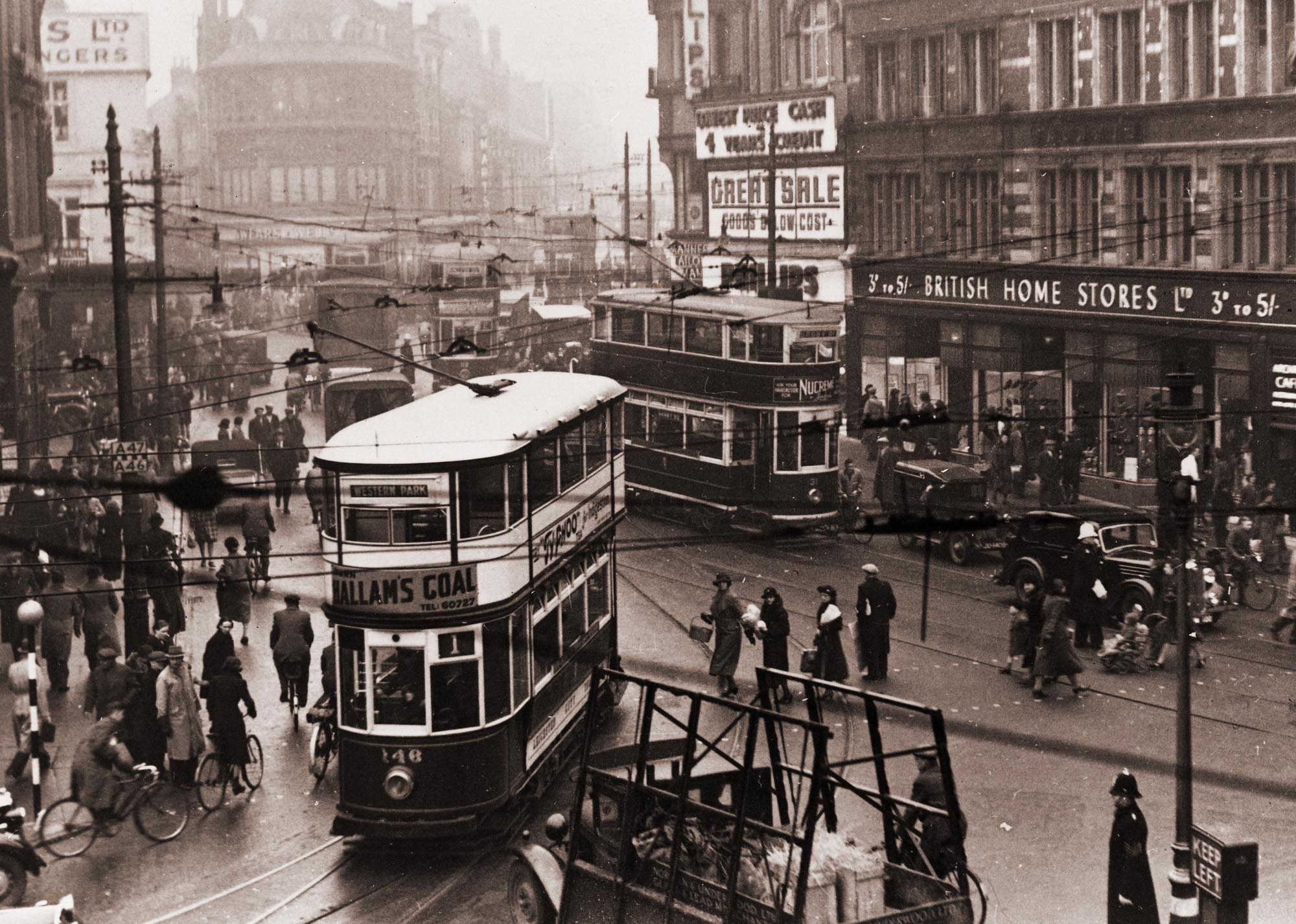 Looking up High Street from the Clock Tower with electric trams in the foreground c.1930 -