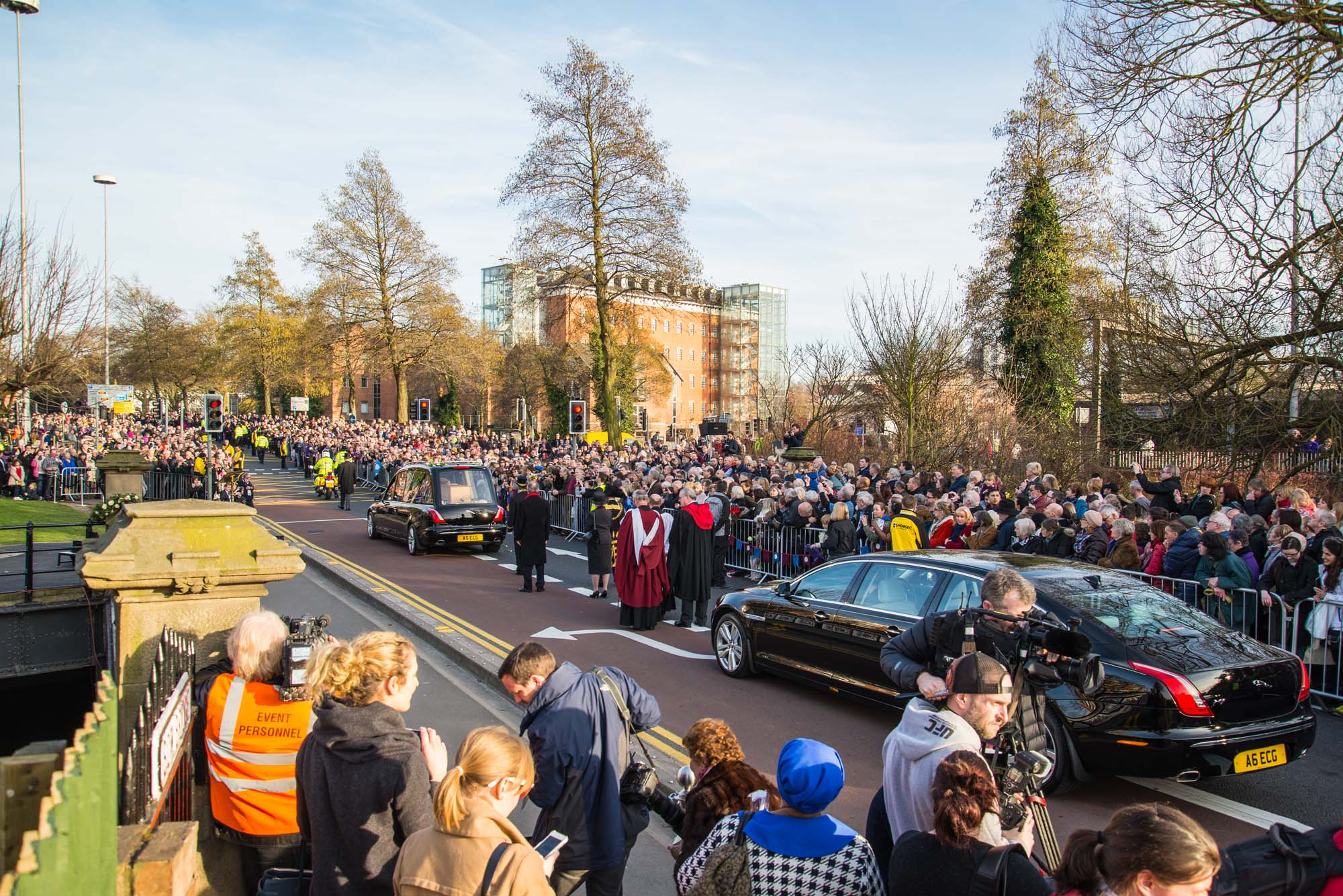 Richard III's remains passing over the Bow Bridge with large crowds watching, 2015 -