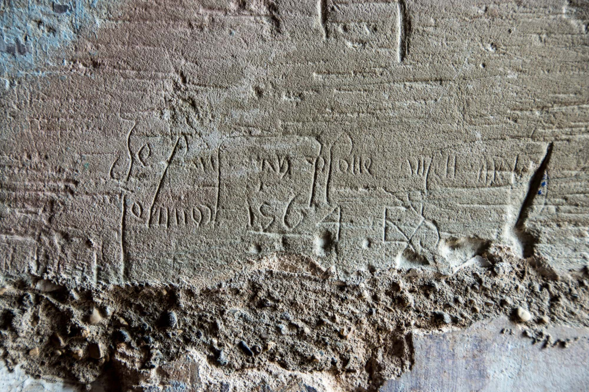 Graffiti left by the Catholic Edmund Smith, imprisoned in The Magazine in 1564 -
