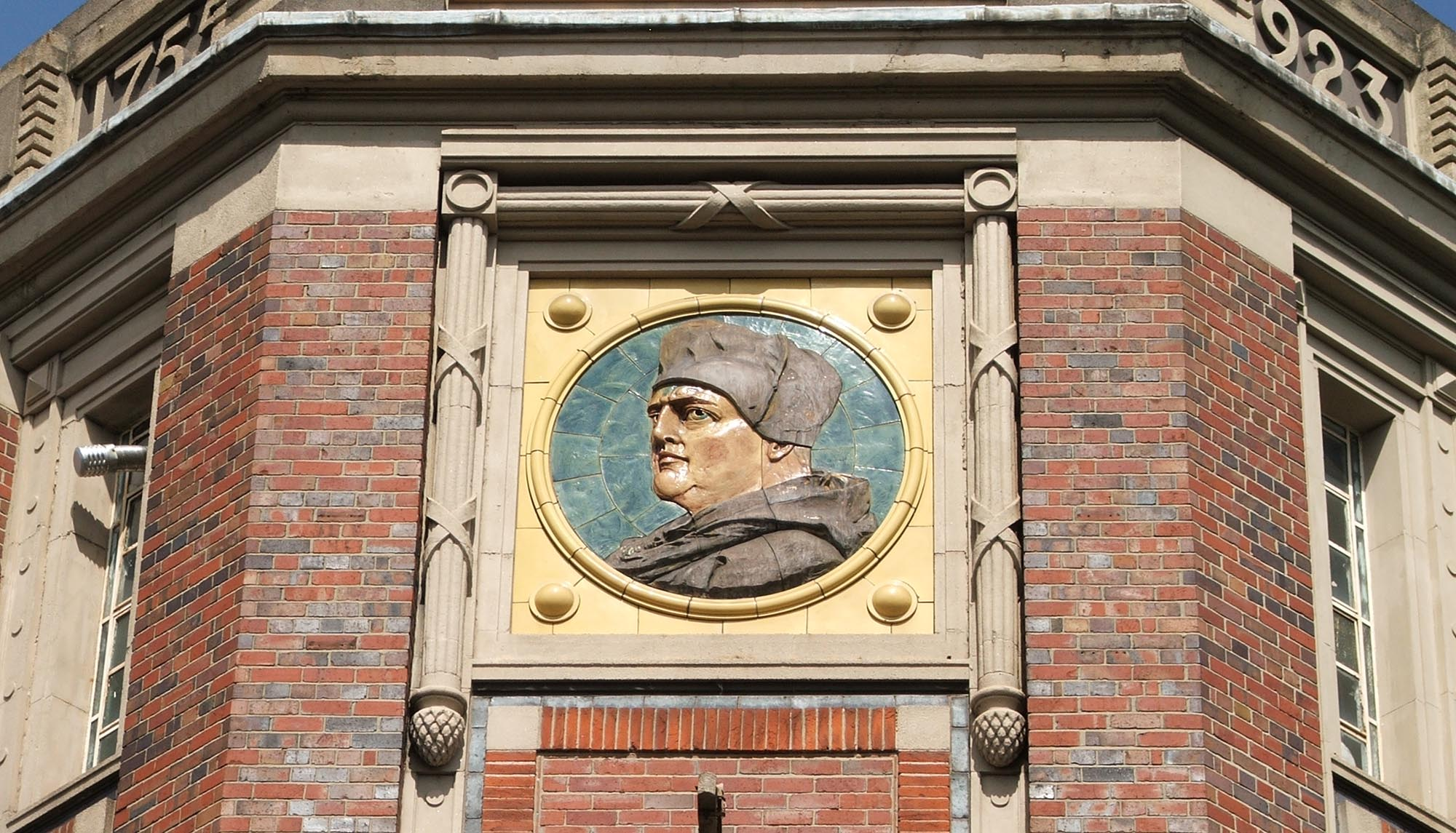 A large portrait of Cardinal Wolsey on the former Wolsey Knitwear Factory near to Abbey Park, built in 1923 -