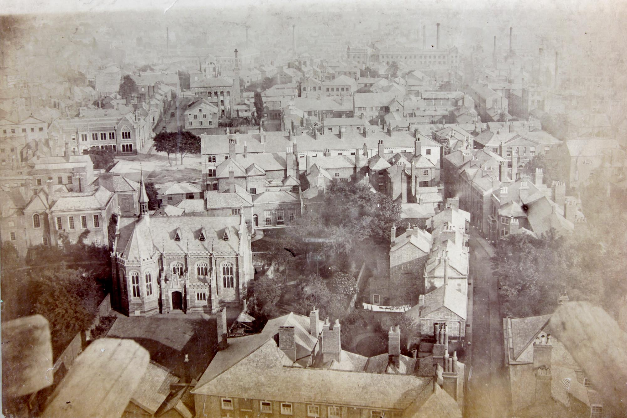 The Grey Friars site from St Martin's steeple in 1867, looking south. In the foreground is the Alderman Newton's School (today the Richard III Visitor Centre) before it was extended in 1887 and 1897. Richard III's grave was found in the garden to the right of the school - Leicester Record Office
