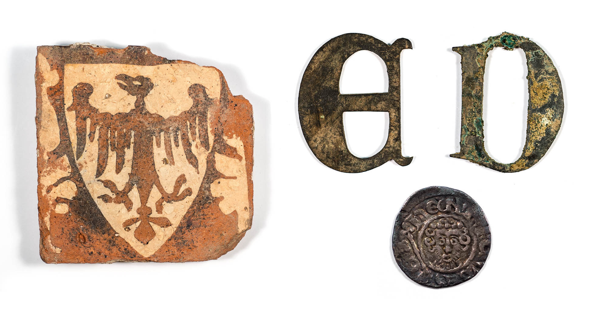 A selection of artefacts found during the excavation of the Grey Friars church: inlaid floor tile, tomb lettering and a coin - See artefacts like this at the Guildhall