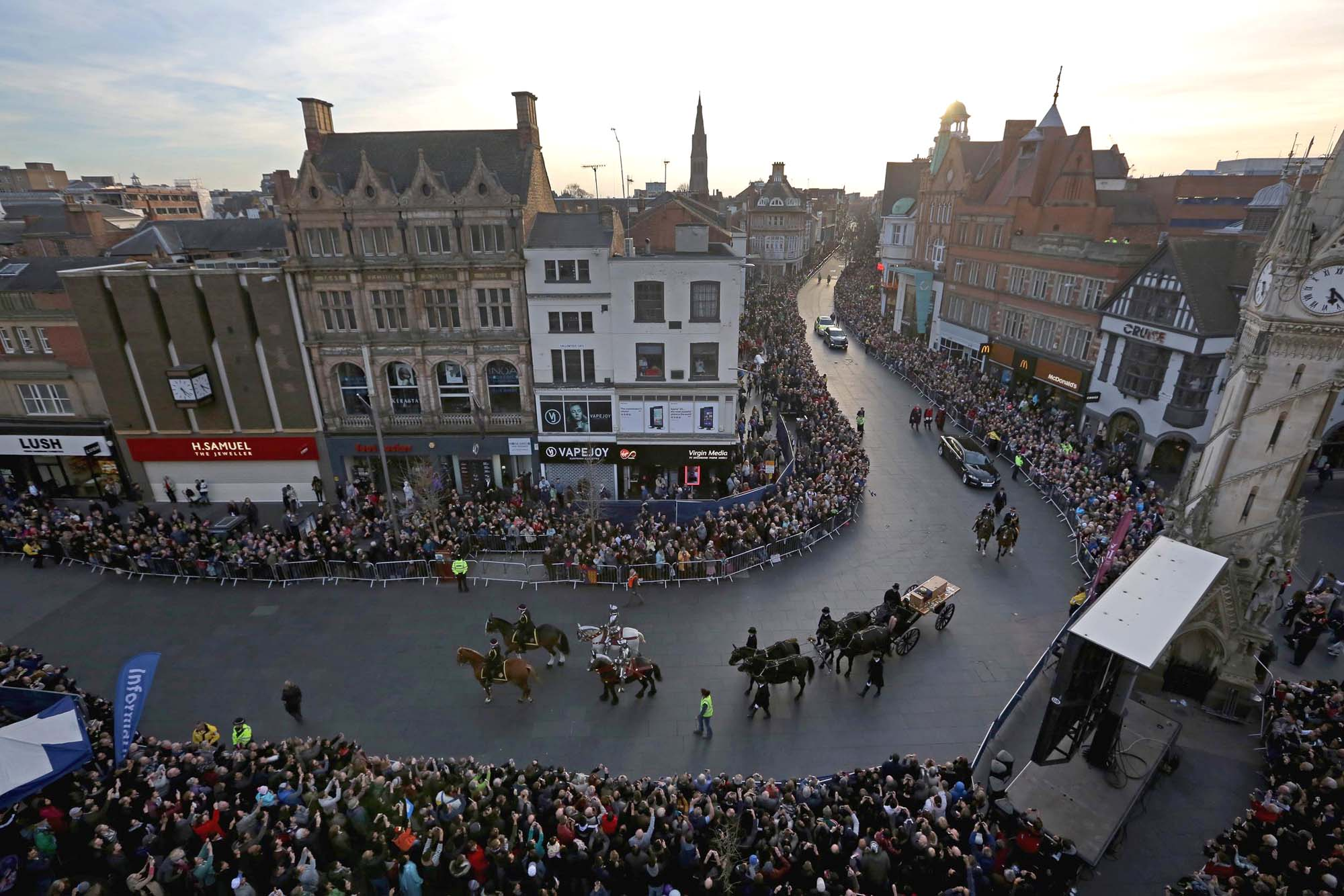 The cortege passes the Clock Tower during the reinterment of Richard III in 2015 -
