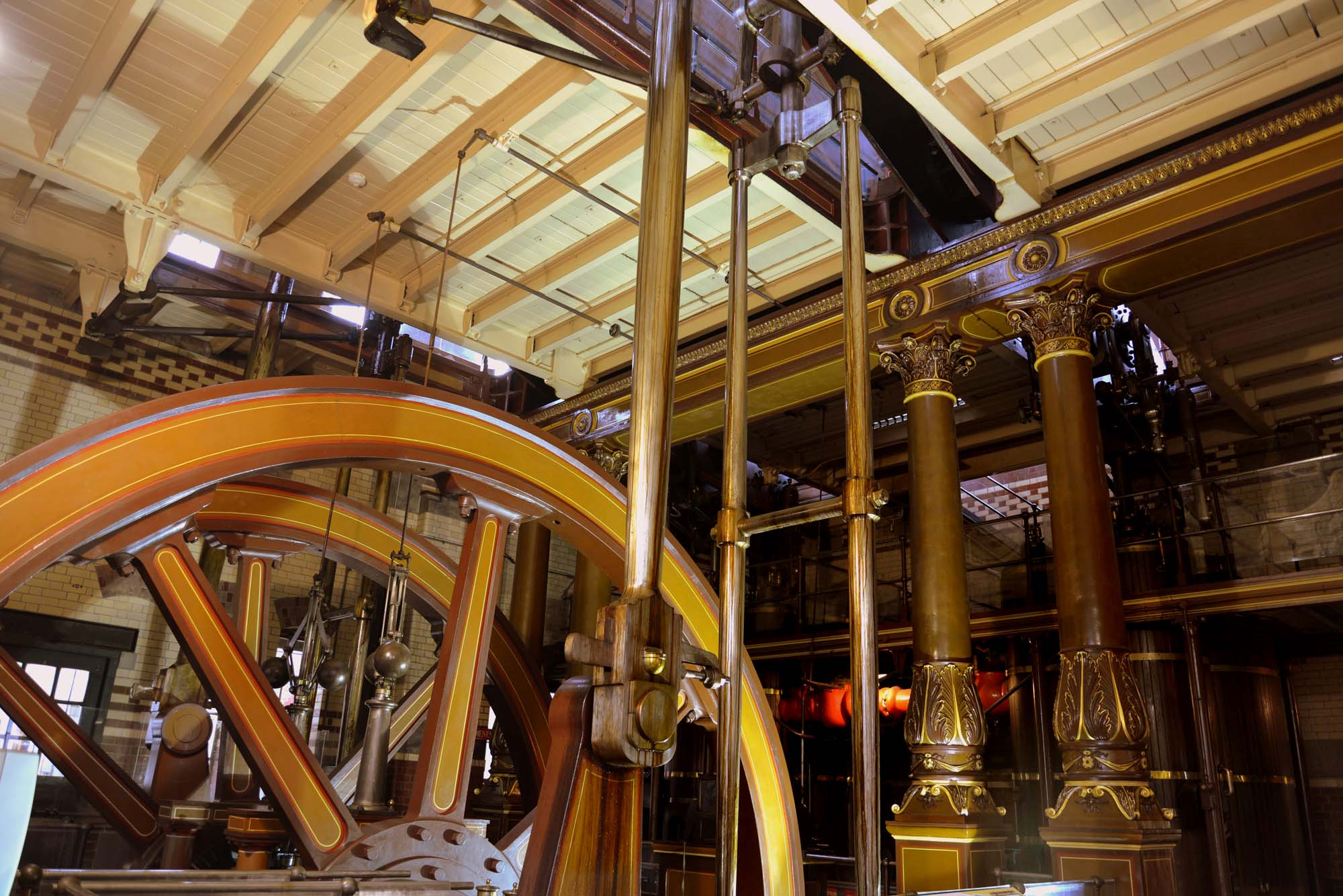 One of the large flywheels and the ornate ironwork of the beam engines -