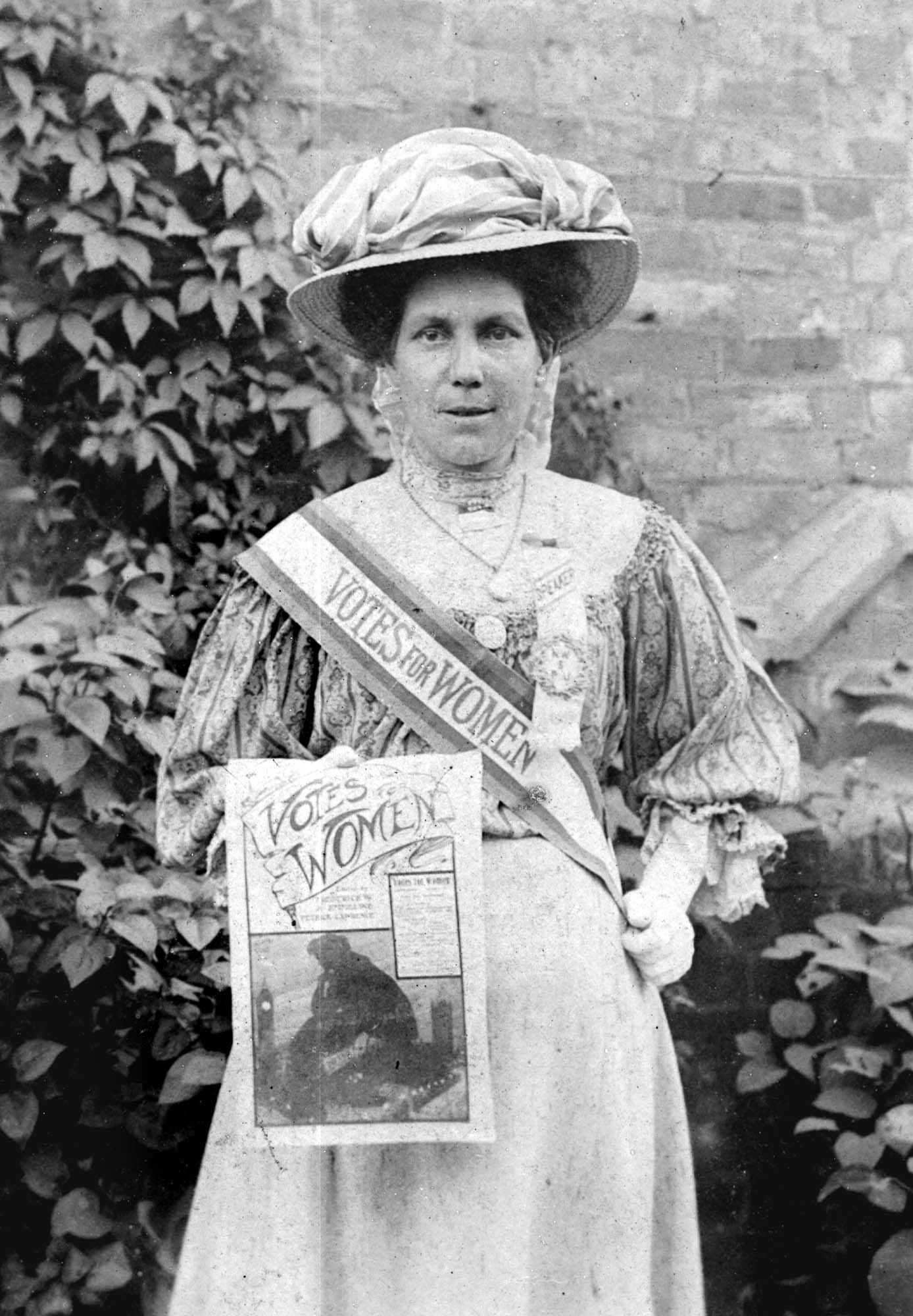 A portrait of Alice Hawkins wearing her suffrage sash and rosette - Peter Barratt