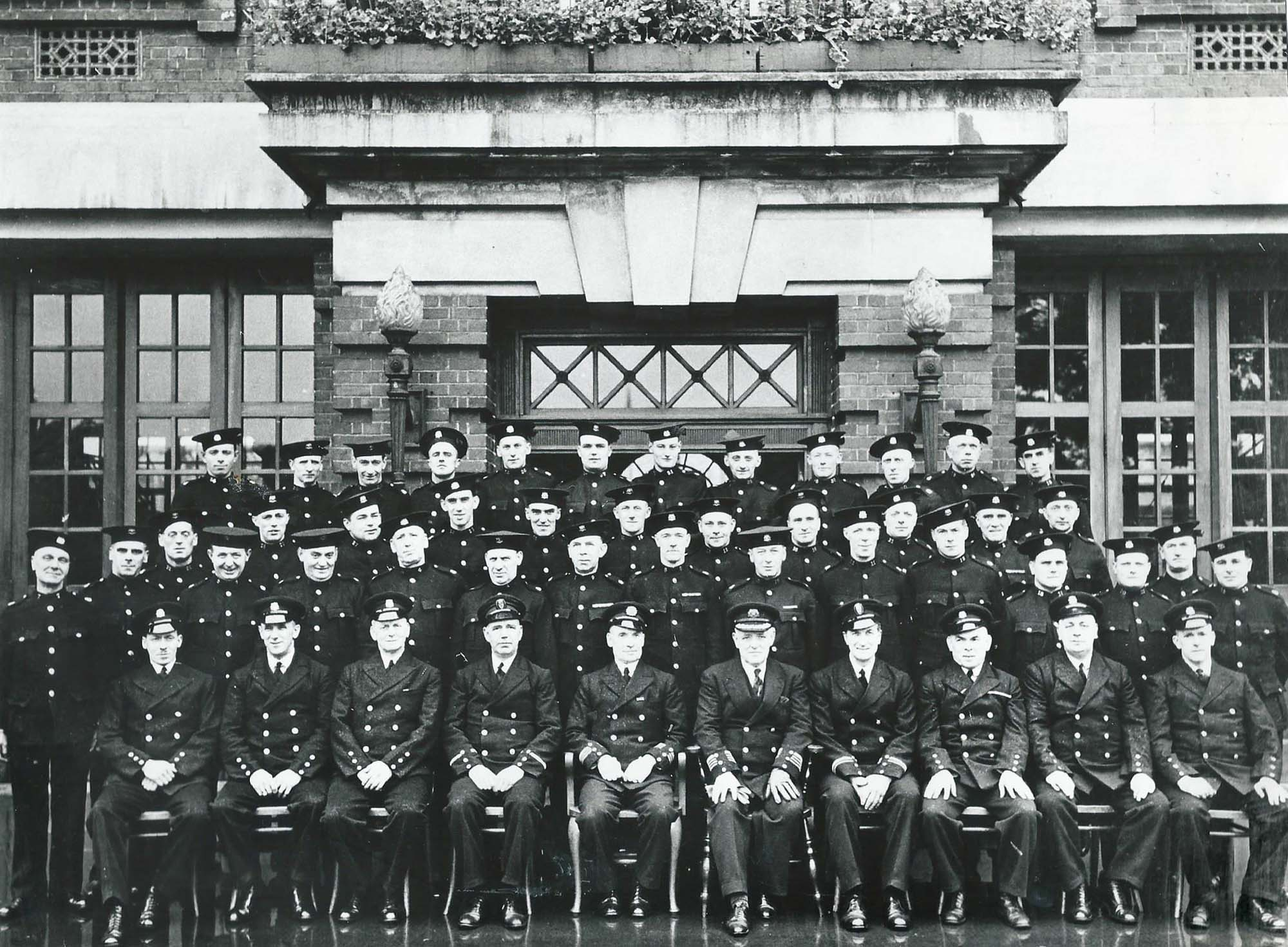 Fireman pose for a photo around 1936, possibly at a retirement get together - Malc Tovey