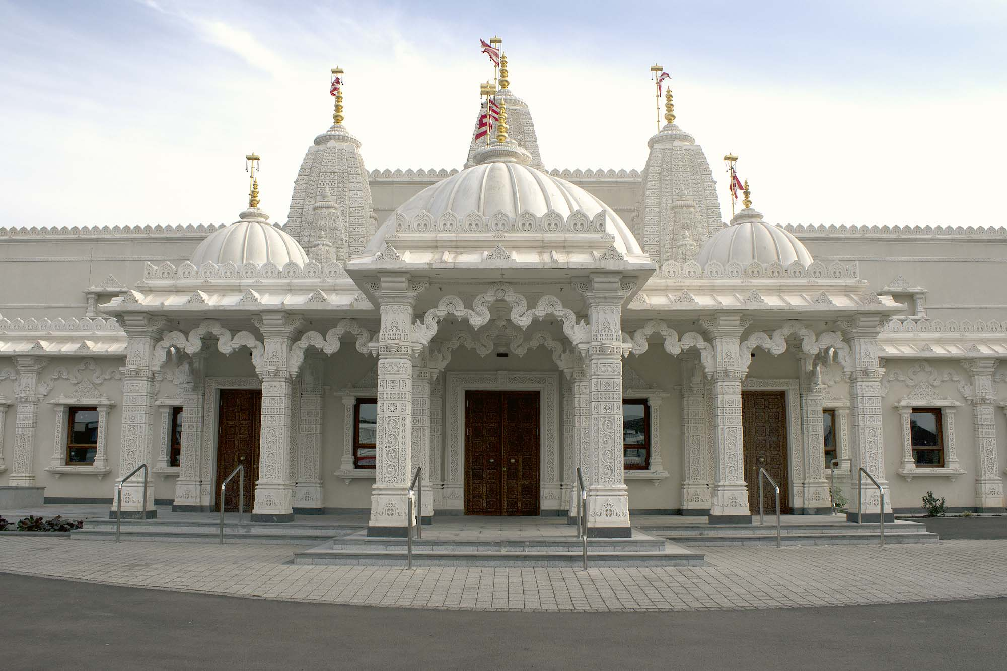 The front entrance has white limestone that was exquisitely carved in India -