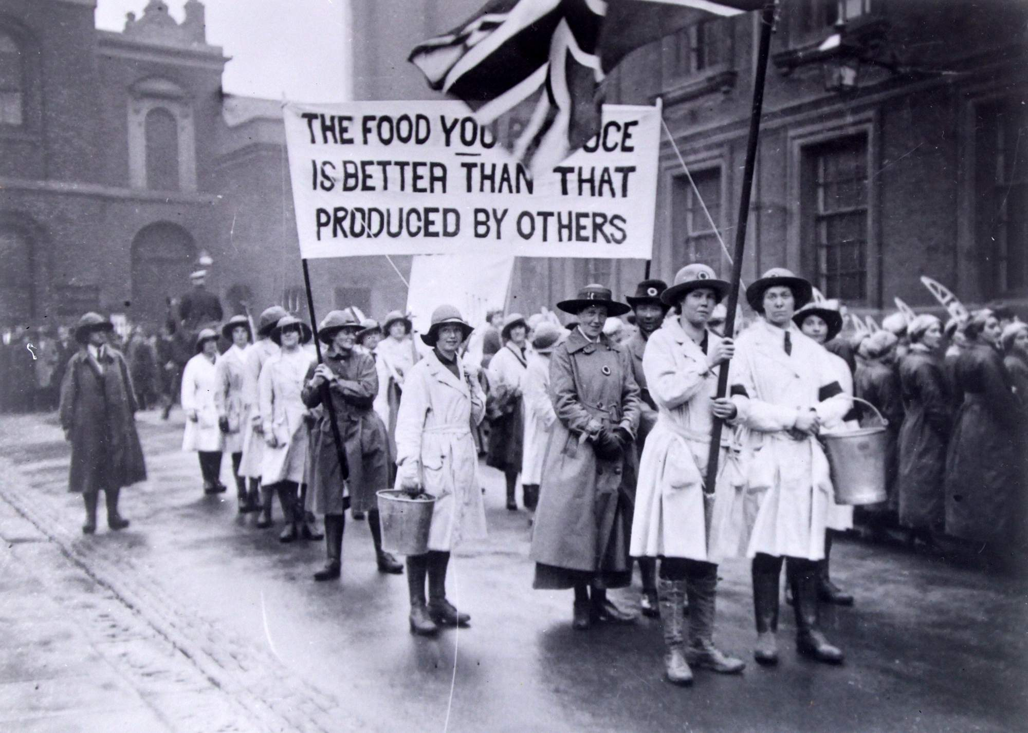 The Women's Land Army was a British civilian organisation created so women could work in agriculture, replacing men who had been called up. Seen here on parade outside the Town Hall. - Leicestershire Record Office