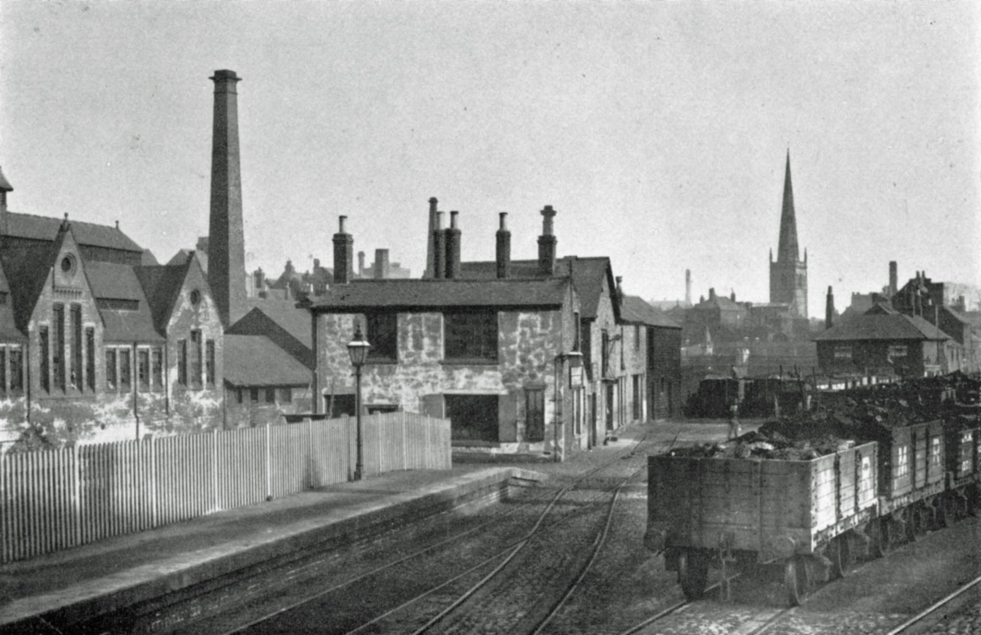 The first West Bridge Station with narrow platform, Mary De Castro Church spire is in the background -