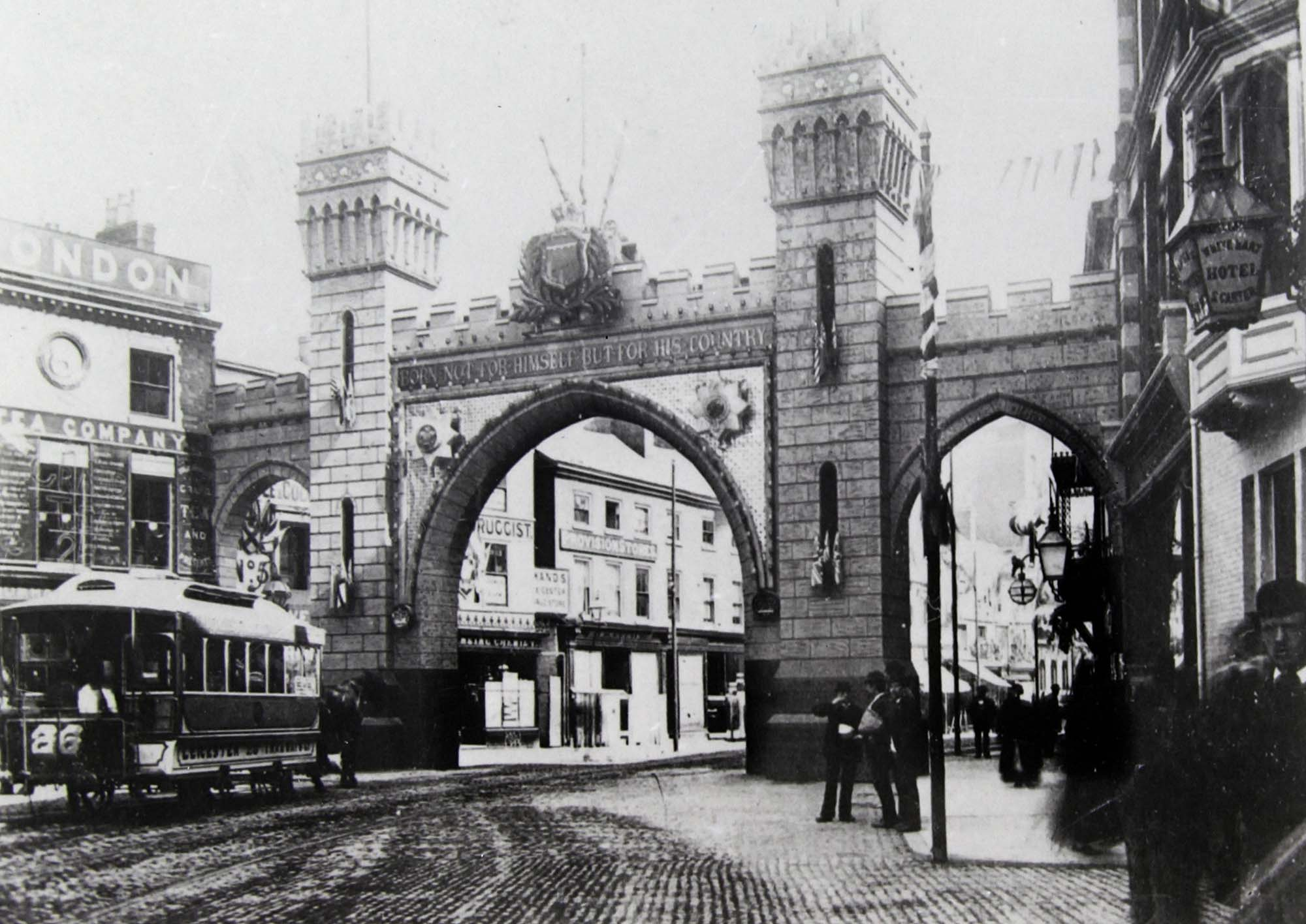 A temporary arch built for the royal visit of the Price of Wales in 1882. This one was at the top of Belgrave Gate near the Clock Tower but there were more around the city - Leicestershire Record Office