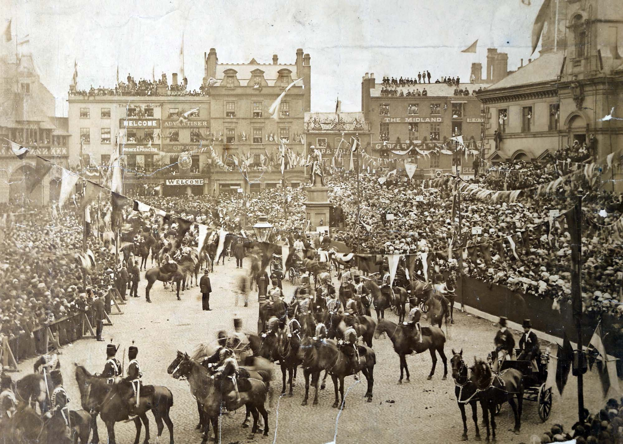 The Prince and Princess of Wales and  Princess of Wales passing by crowds in Leicester Market on the way to open Abbey Park, 1882 - Leicestershire Record Office